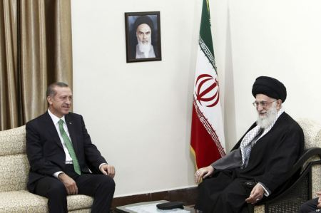 Erdogan (the Goat's horn) meets with Khamanei (the Ram's first horn) to try to cooperate - AP Photo