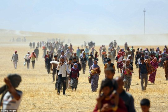 Yazidi people escaping IS