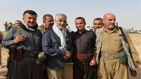 Suleimani having his picture taken with Kurdish fighters