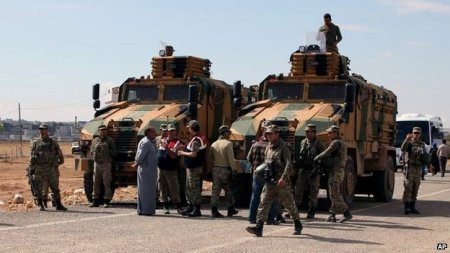 Turkish military unit at border with Syria.    (AP photo)