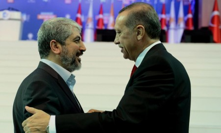 Hamas leader Khalid Mashal shares an embrace with Turkish President Erdogan during a trip to Turkey last week
