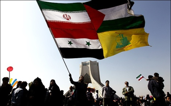 A composite flag being waved in Tehran composed of the flags of (starting upper left, clockwise) Iran, Palestine, Hezbollah, and Syria.