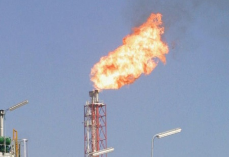 Natural gas burning off from a well in Qatar.