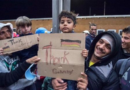 Refugees arrive at a train station in central Germany, Sept. 5, 2015. (AP Photo/Jens Meyer)