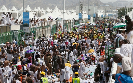 Pilgrims and rescuers gather around where people where people were stampeded and died.  This occurred in Mina, a tent city housing two million adjacent to Mecca on September 24. (AP Photo)