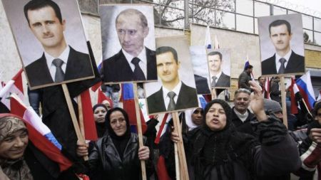Supporters of Assad and Putin rally.