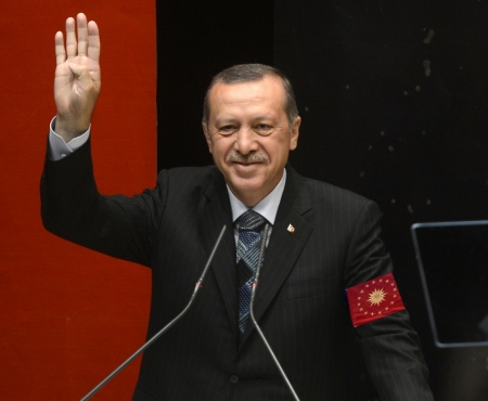 A possible glimpse of the future?  Erdoğan addressing his people, wearing the seal of the imperial presidency, shouting Hail Erdoğan!