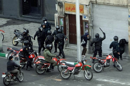 A common sight in the 2009 election: Basij paramilitary getting off their fiery red motorcycles to beat up another protester.