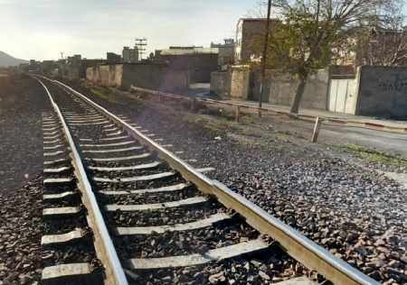 The single set of tracks of the Trans Iranian railroad, going through Arak, Iran.  Arak is on the north side of the mountains and halfway between Tehran and Susa.