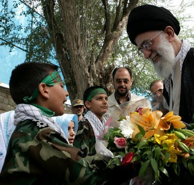 The top king of the Medes and Persians has a moment with one of his child fighters. Knowing this, the smile on Khamenei's face is creepy.