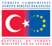 The logo of Turkey's application to the EU.  The logo seems to display the problem with Turkey joining Europe.  One big Islamic star trying to fit in with a bunch of little golden European nations.