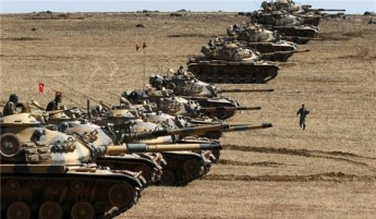 Turkish tanks lining up on the border with Syria prior to August.