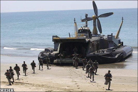 "Iranian ""marines"" being deployed on a beach in an earlier naval exercise. Their landing craft is a BH7 hovercraft."