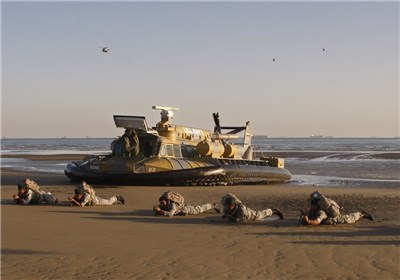 Photo op during an earlier naval exercise using an SRN6 hovercraft and some marines getting into position to take a beach.